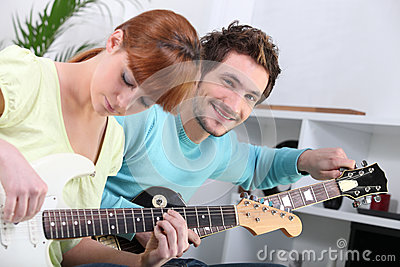 Guitar teacher and his student
