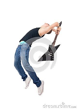 Guitarist breaking his guitar