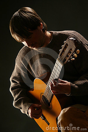 Guitarist classical acoustic guitar playing