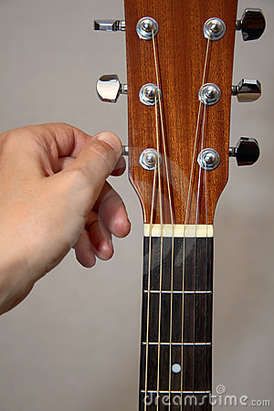 Free Guitarist Hand Tuning Acoustic Guitar Royalty Free Stock Photography - 19482367