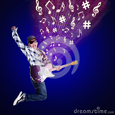 Guitarist jumping with musical notes on blue
