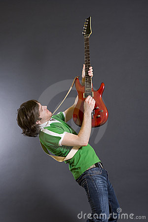 Guitarist playing his guitar in the air