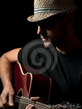 Guitarist playing solo on the acoustic guitar