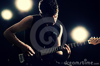 Guitarist playing on the stage