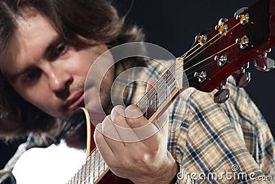 Guitarist plays on a guitar