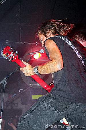 Guitarist singing in a band