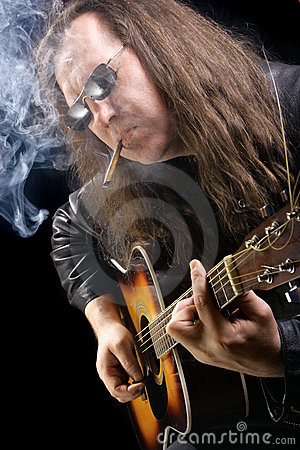 Guitarist smoking cigar