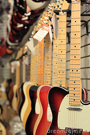 Free Guitars For Sale Hanging Royalty Free Stock Photos - 22642938