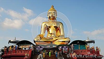 Guld- Buddhastaty