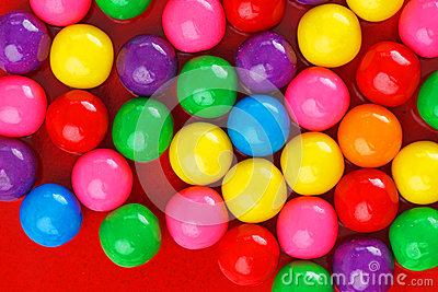 Gumballs on red ceramic