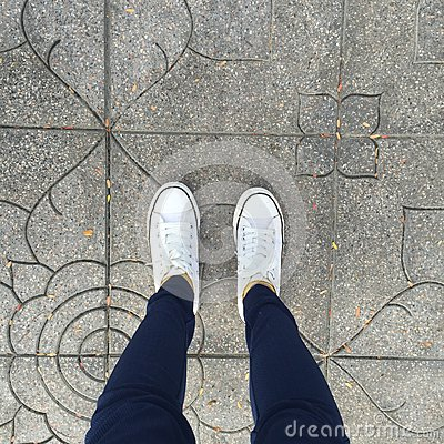 Free Gumshoes On Urban Grunge Background. Conceptual Image Of Legs. Royalty Free Stock Image - 63711646
