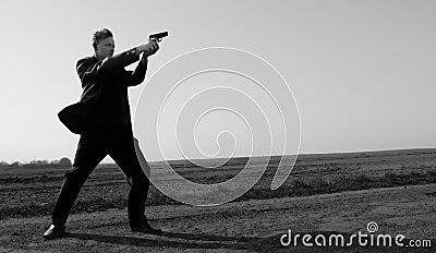 With a gun...