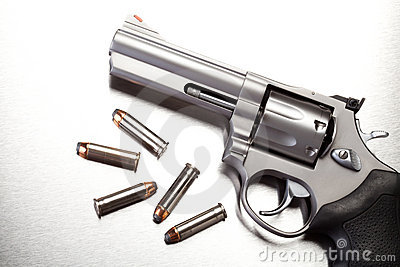 Gun With Bullets On Steel Royalty Free Stock Image - Image: 18917156