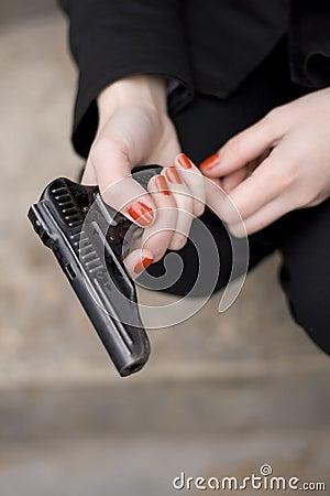 Gun in female hands