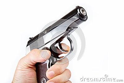Gun in hand on a white.