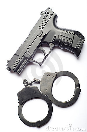 Gun with handcuffs