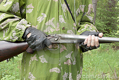 Gun in the hands of the arrow Stock Photo