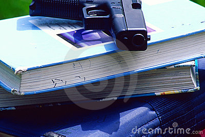 Gun on school books