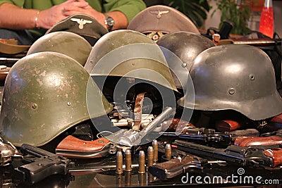 Guns and war helmets