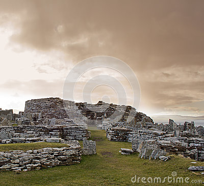 Gurness Broch under stormy sky