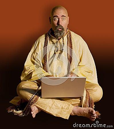 Guru wih a Laptop Computer