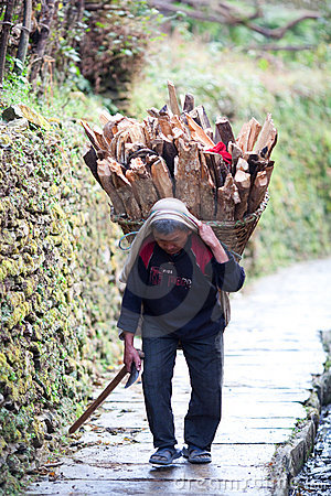 Gurung peasant with basket Editorial Stock Image