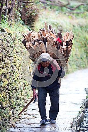 Gurung peasant with basket Editorial Stock Image