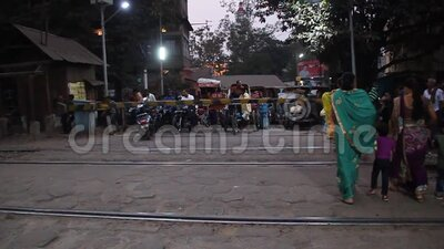 People are waiting at the railway crossing in Guwahati. GUWAHATI, INDIA - JANUARY 31, 2017: People are waiting at the railway crossing in Guwahati, India stock video