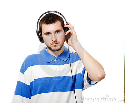 Guy with a beard, listening to music on headphones
