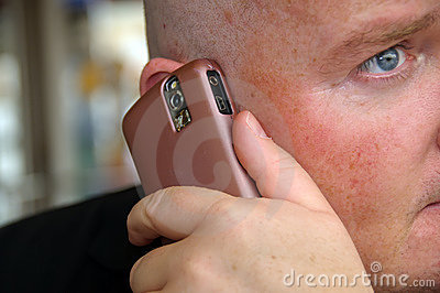 Guy enjoying his communication on mobile phone