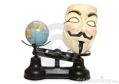 Guy fawkes mask on scales with a globe Editorial Image