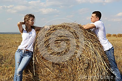 The guy and the girl in the field