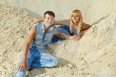 Guy and  girl in  white sand