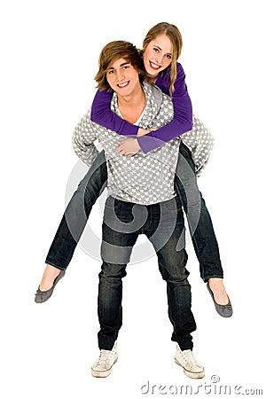 Guy giving girlfriend a piggyback ride