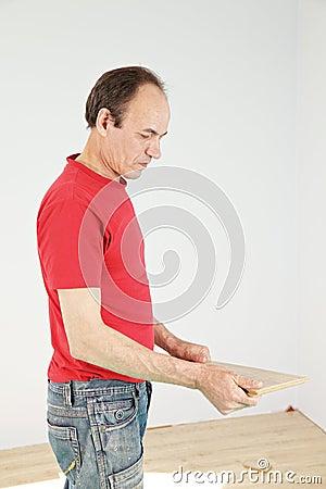 Guy holding plank