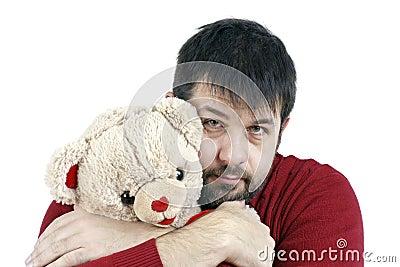 Guy hugging teddy bear