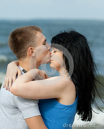 Guy is kissing his girlfriend