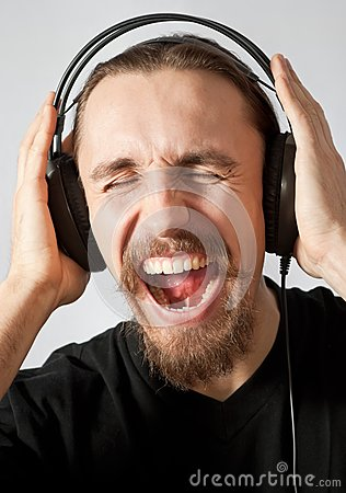 Guy listening to the music and screaming
