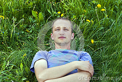 The guy lying on the grass
