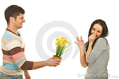 Guy offering flowers to picky woman