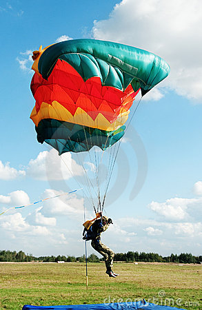 The guy-parachutist  in camouflage overalls