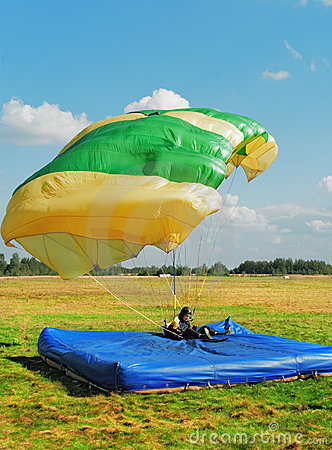 The guy-parachutist has landed on a floor-mat