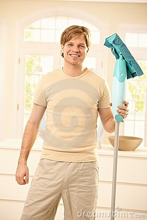 Guy posing with mop