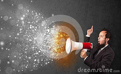 Guy shouting into megaphone and glowing energy particles explode