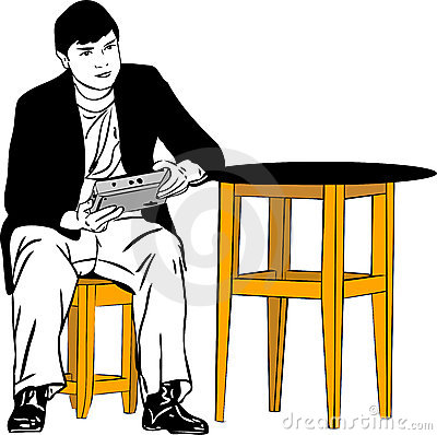 a guy sitting on a stool at the table