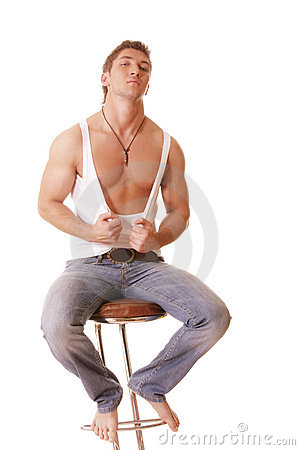 Guy in sleeveless shirt and jeans sitting on chair