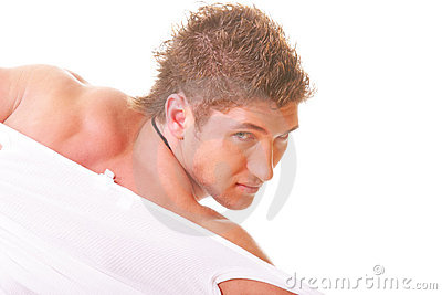 Guy tearing shirt