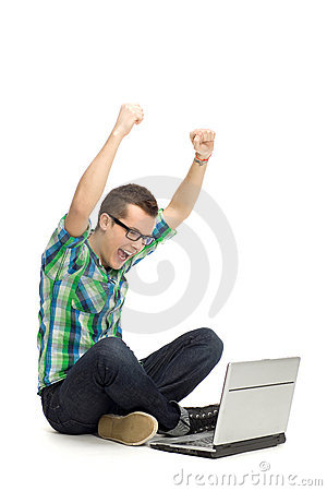 Guy using laptop with arms raised