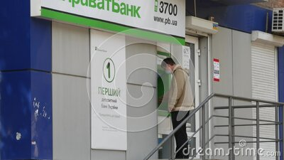 Guy withdraws money with ATM from credit card. City quarantine due coronavirus stock video