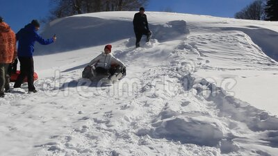 Adults and children ride on the snow slope. stock footage